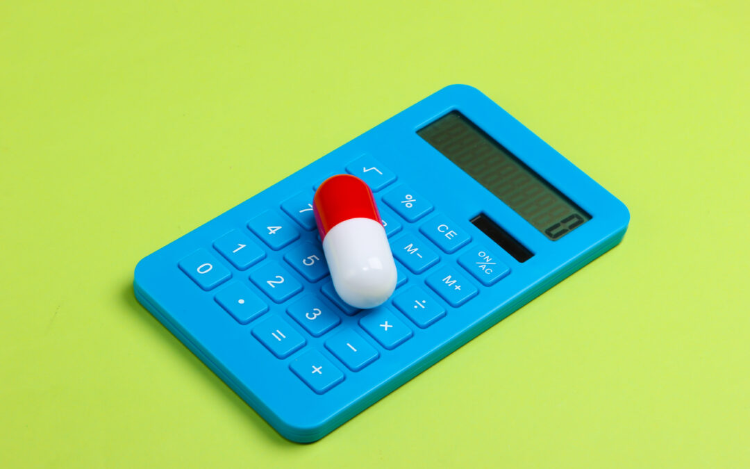 Price Elasticity of Demand in pharma. Calculator and pill on green background.